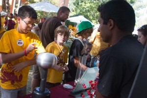 Engineers presenting hands-on demonstrations at Homecoming Block Party 2011.