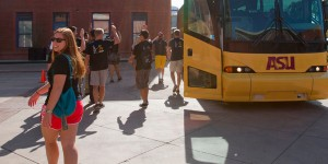 Students board the buses headed for E2