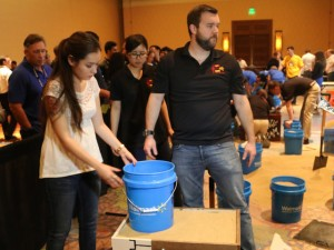 ASU students Devinne Ramirez (left) and John Furniss built a small-scale mechanically stabilized earth wall for a student competition at the recent international industry conference. Ramirez is an undergraduate construction engineering major. Furniss is a graduate student in geotechnical engineering.