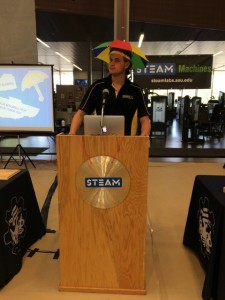 James Larson, a sophomore in electrical systems engineering, announces the winners of the STEAM Labs Awards.