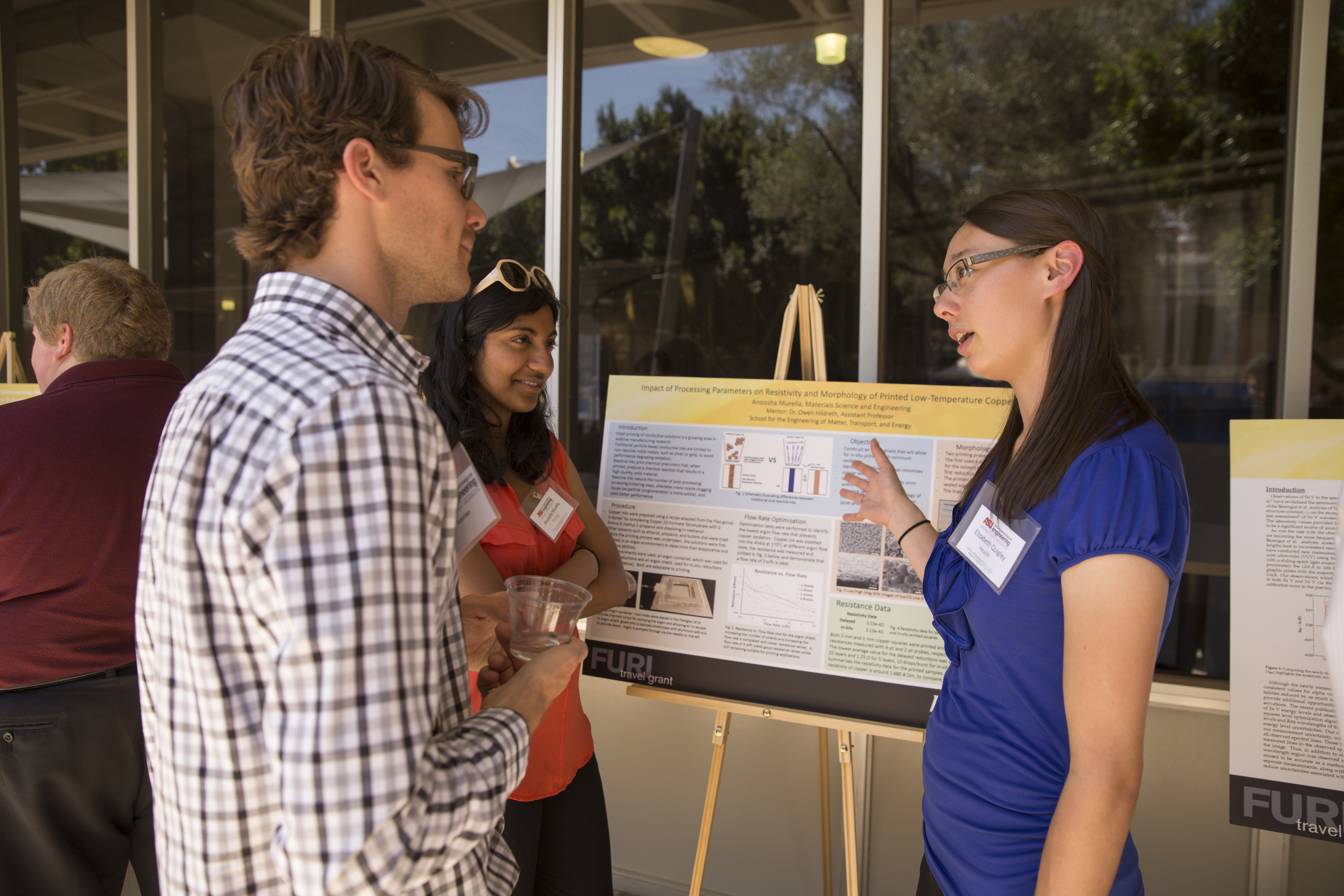 Students discuss their research at the FURI Symposium