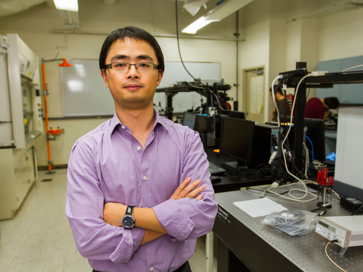 Assistant Professor Liping Wang in his lab.