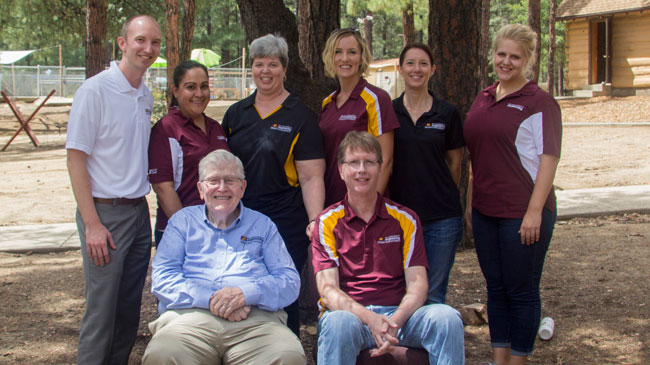 This photo shows Fulton Schools staff with Ira A. Fulton.
