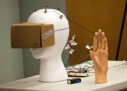 A mannequin head wears a Google Cardboard headset.