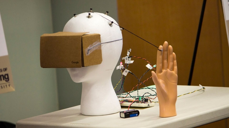 A mannequin head wears a Google Cardboard headset.