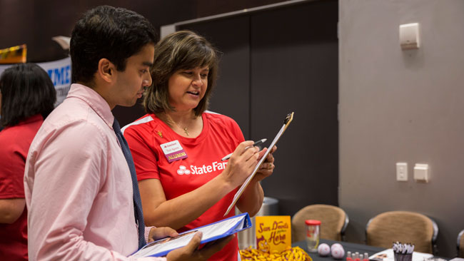 A student and recruiter talk at career fair