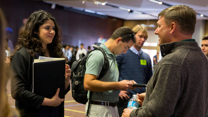 A student and recruiter talk at the Fulton Schools Career Fair