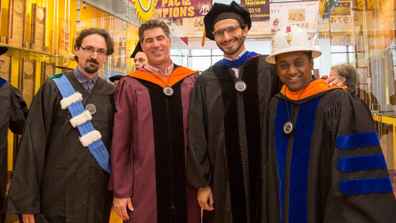 Faculty pose with their doctoral students at Convocation.