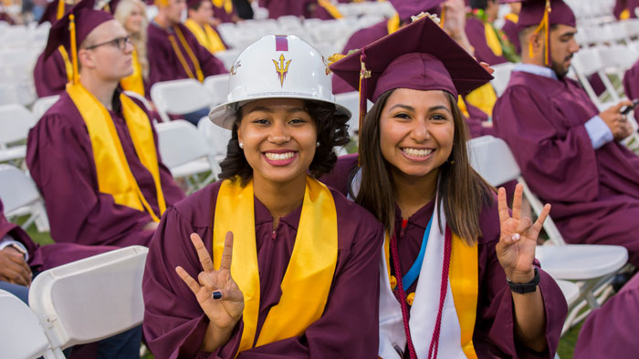 Two students pose at ASU Commencement