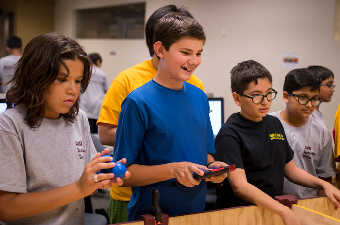 Students drive a robot in the 7Up Robotics Camp