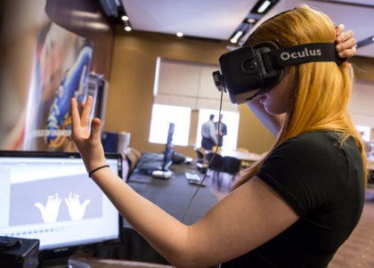 A visitor tests an Oculus Rift robotics application at Rehab Robotics.