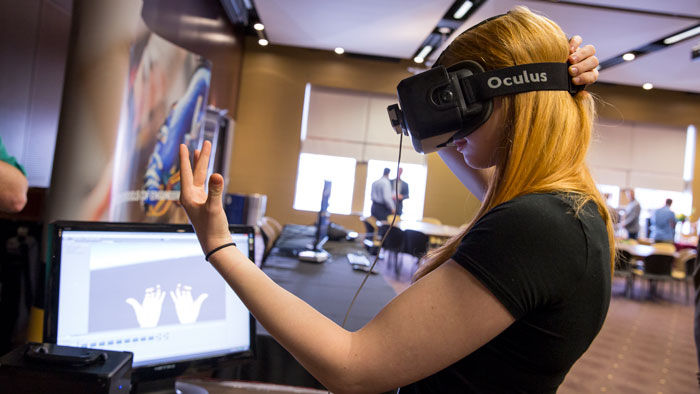 A visitor tests an Oculus Rift robotics application at Rehab Robotics.