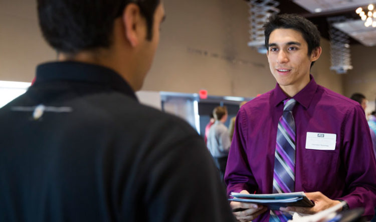 A student talks with a recruiter at Career Fair.