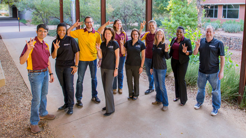 Fulton Schools faculty pose in ASU attire.