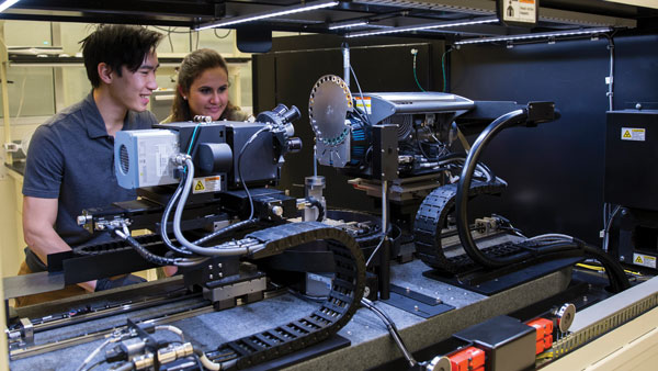 Two students work in Nik Chawla's lab at ASU.