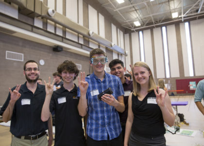 A group of students pose at the Innovation Showcase event.