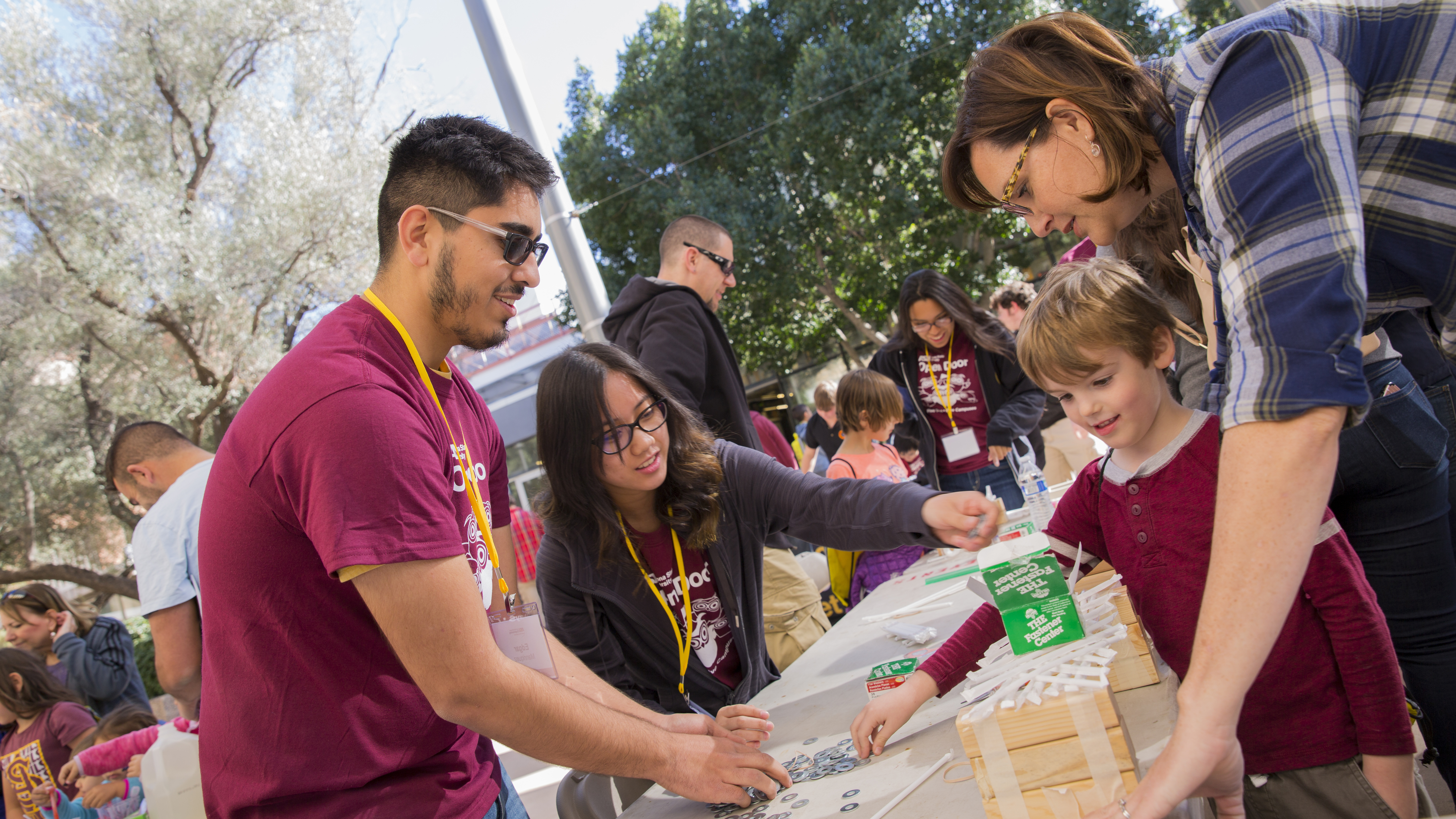 Child and ASU students at ASU Open Door 2018