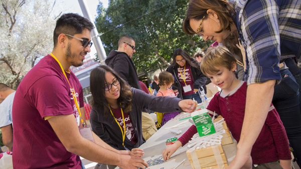 Volunteers interact with guests at ASU Open Door