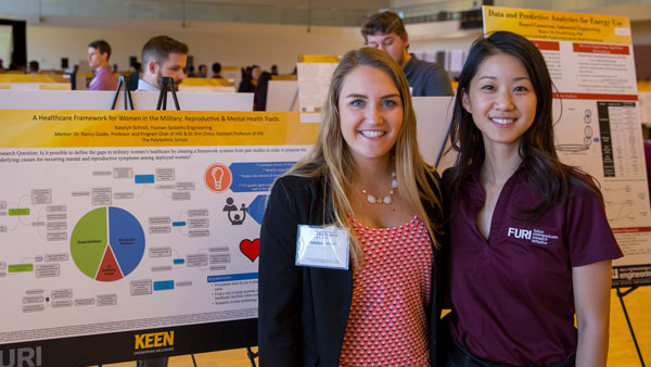 A student and mentor pose at the FURI Symposium
