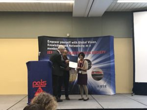 Jinia Roy accepts her award at the IEEE PELS flagship conference.
