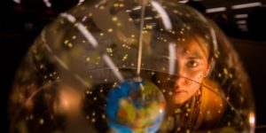 Woman looking at a globe.