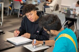 Student working with a tutor