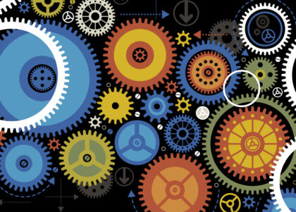 Colorful gears on a dark background.